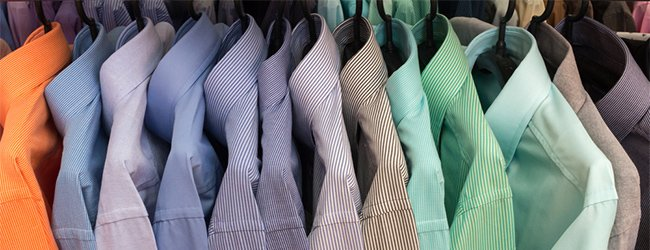 different coloured shirts on hangers