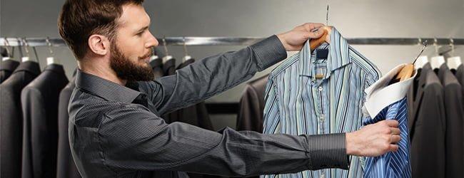 man choosing striped shirt