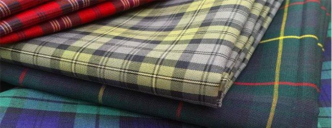 pile of tartan fabrics