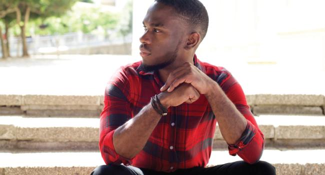 black man red shirt